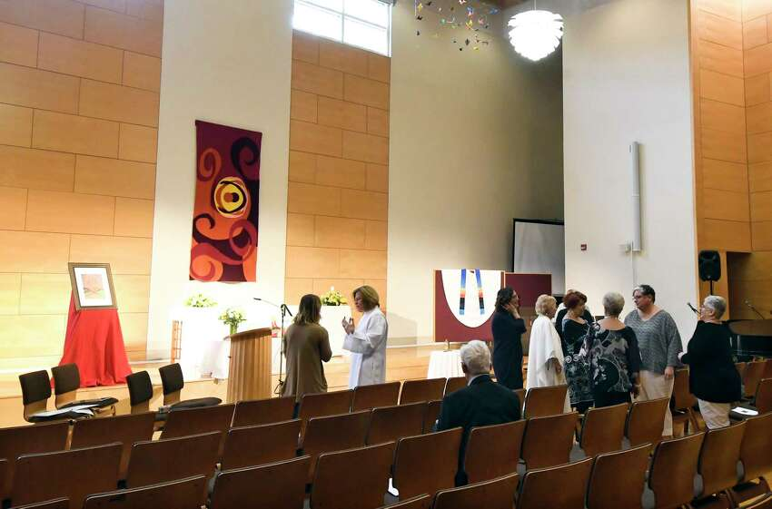 Lynn Kinlan of Guilderland, N.Y., second from left, talks with friends before her ordination ceremony as a Roman Catholic priest at the Unitarian church Saturday, Sept. 8, 2018, in Albany, N.Y.