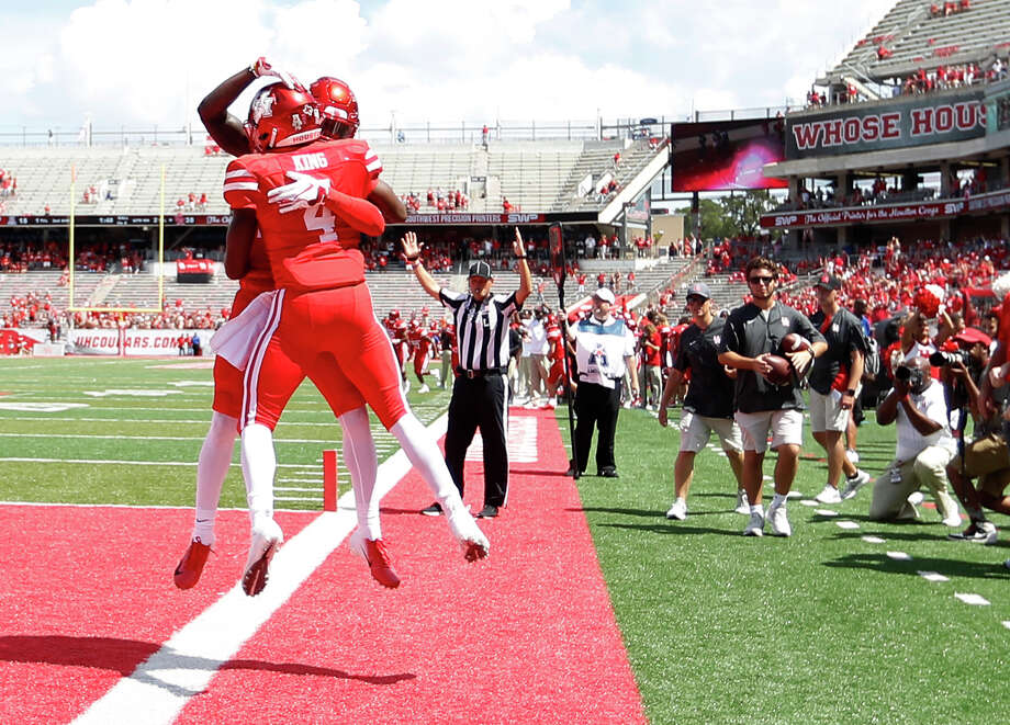 Houston Cougars quarterback D'Eriq King (4) celebrates his touchdown with Houston Jeremy Singleton (10) during the second half of a college football game at TDECU Stadium, Saturday, September 8, 2018, in Houston. Photo: Karen Warren, Staff Photographer / © 2018 Houston Chronicle