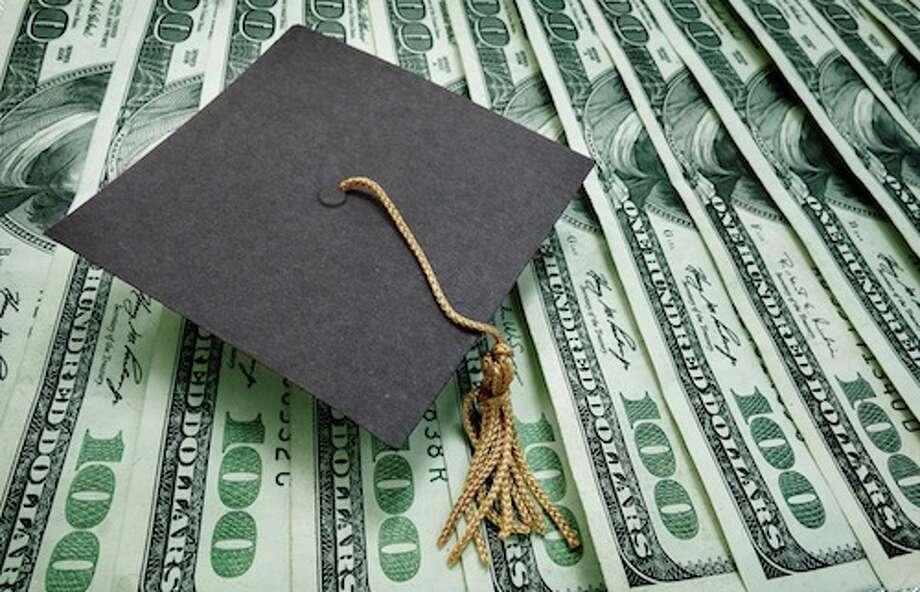 graduation cap on assorted hundred dollar bills - education concept / zimmytws - Fotolia