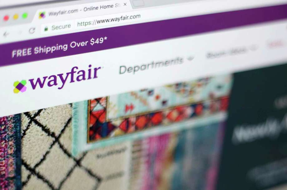 FILE- This April 17, 2018, file photo shows the Wayfair website on a computer in New York. online retailers are trying hard to get more people to buy stoves, washing machines and other large appliances without seeing them in person. Wayfair, for example, signed a deal last year to sell GE appliances on its site. (AP Photo/Jenny Kane) Photo: Jenny Kane / ap