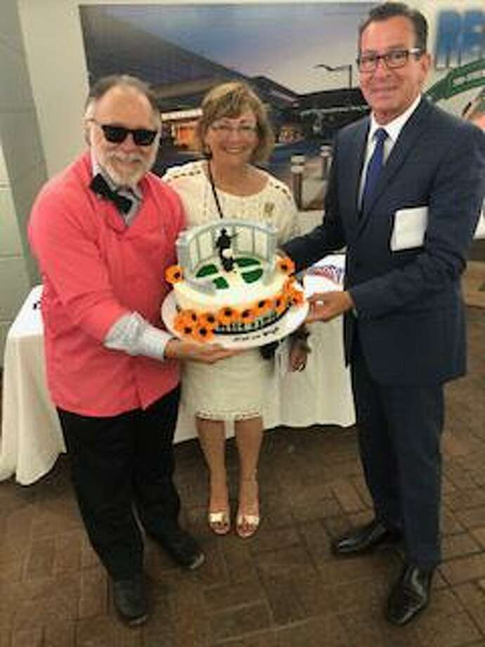 From left, Sky Mercede of Forever Sweet Bakery, who provided the cake, attends the groundbreaking at Veterans Park in Stamford with Patricia Parry and Gov. Dannel Malloy. Photo: Contributed /
