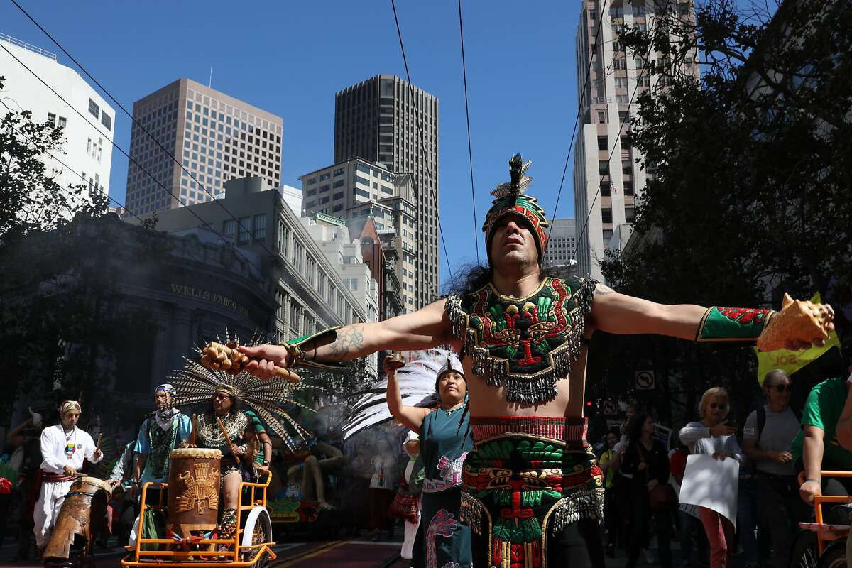 Members of the Danza Azteca Grupo Xiuhcoatl, from the Mission District, dance on Market Street during the RISE for Climate, Jobs, and Justice march on Saturday, September 8, 2018, in San Francisco, Calif. Thousands marched through the streets of San Francisco, just days before the Global Climate Action Summit next week.