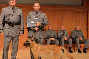 State Police Superintendent George P. Beach II, left, poses with Trooper Matthew P. Rufa and his new canine partner, Kinson, during a graduation ceremony on Aug. 7, 2018, in Albany, N.Y. The pair will serve Troop G in the Capital Region. (State Police)