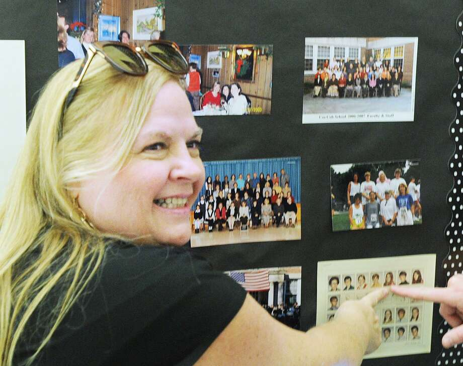 """Ruth Orrico of Greenwich points to a photo of herself in the 1971 Cos Cob School yearbook during the Cos Cob School Homecoming Community Picnic in which 100 years of the school's history was celebrated with a community party at the school located at 300 E. Putnuam Ave., Greenwich, Conn., Saturday, Sept. 8, 2018. Former Cos Cob School principal Dominic Butera who is now retired and gave a speech during the event commented about the occassion """"To have been a part of this, a stitch in the fabric of this school that is the heart of the community, it has deep meaning and is moving."""" Photo: Bob Luckey Jr. / Hearst Connecticut Media / Greenwich Time"""