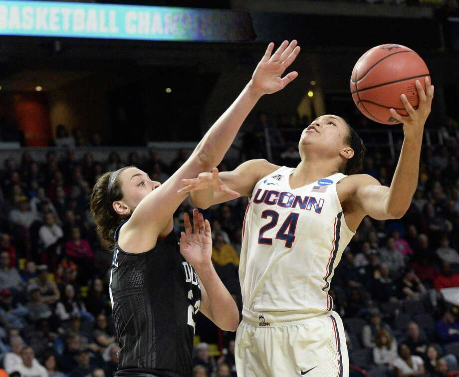 UConn's Napheesa Collier, right, muscles a shot past Duke's Rebecca Greenwell during their NCAA Women's Tournament regional semifinal on March 24 at the Times Union Center in Albany, N.Y. Photo: John Carl D'Annibale / Albany Times Union / 20043277A