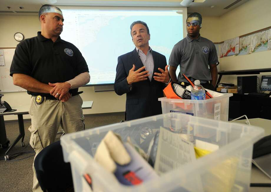 From left; Director of Emergency Management and Homeland Security Scott Appleby, Bridgeport Mayor Joe Ganim, and Terron Jones with emergency preparedness kits at the Emergency Communications & Operations Center in Bridgeport, Conn. on Thursday, September 6, 2018. Jones was just named Bridgeport's new PIO by Ganim. Photo: Brian A. Pounds / Hearst Connecticut Media / Connecticut Post
