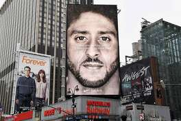 A Nike Ad featuring American football quarterback Colin Kaepernick is on diplay September 8, 2018 in New York City. - Nike's new ad campaign featuring Kaepernick, the American football player turned activist against police violence, takes a strong stance on a divisive issue which could score points with millennials but risks alienating conservative customers. The ads prompted immediate calls for Nike boycotts over Kaepernick, who has been castigated by US President Donald Trump and other conservatives over his kneeling protests during the playing of the US national anthem. (Photo by Angela Weiss / AFP)ANGELA WEISS/AFP/Getty Images