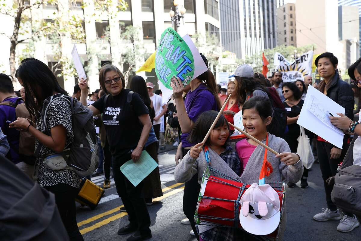 (Left to right) Best friends Kelly Li, 7.5 years old, and Fiona Yu, 8, playfully hit a drum as they march with the Chinese Progressive Association, a workers rights campaign based in San Francisco�s Chinatown, during the RISE for Climate, Jobs, and Justice march on Saturday, September 8, 2018, in San Francisco, Calif. Thousands marched through the streets of San Francisco, just days before the Global Climate Action Summit next week.