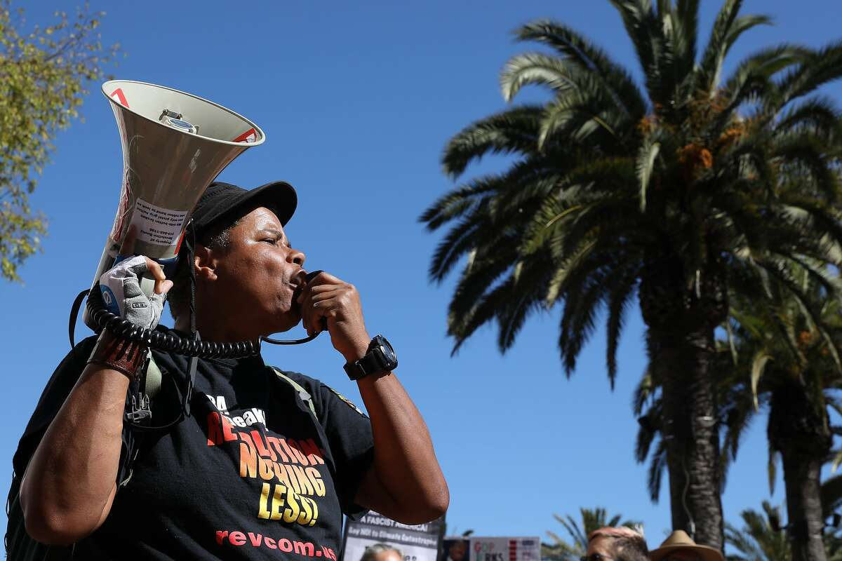 Xochitl Johnson, with the Revolution Club Bay Area, speaks during the RISE for Climate, Jobs, and Justice rally at Embarcadero Plaza, on Saturday, September 8, 2018, in San Francisco, Calif. Thousands marched through the streets of San Francisco, just days before the Global Climate Action Summit next week.