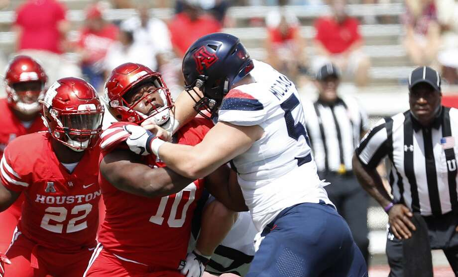 Houston Cougars defensive tackle Ed Oliver (10) works against Arizona Wildcats offensive lineman Josh McCauley (50) during the first half of a college football game at TDECU Stadium, Saturday, September 8, 2018, in Houston. Photo: Karen Warren/Staff Photographer