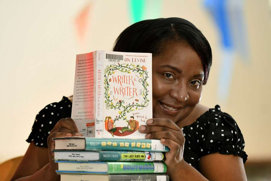 Lakisha Sparrow, a Lone Star College - Tomball Community Library adult services specialist, came up with an unusual idea for a community novel, where 20 authors each write a chapter of a book. Photo: Jerry Baker