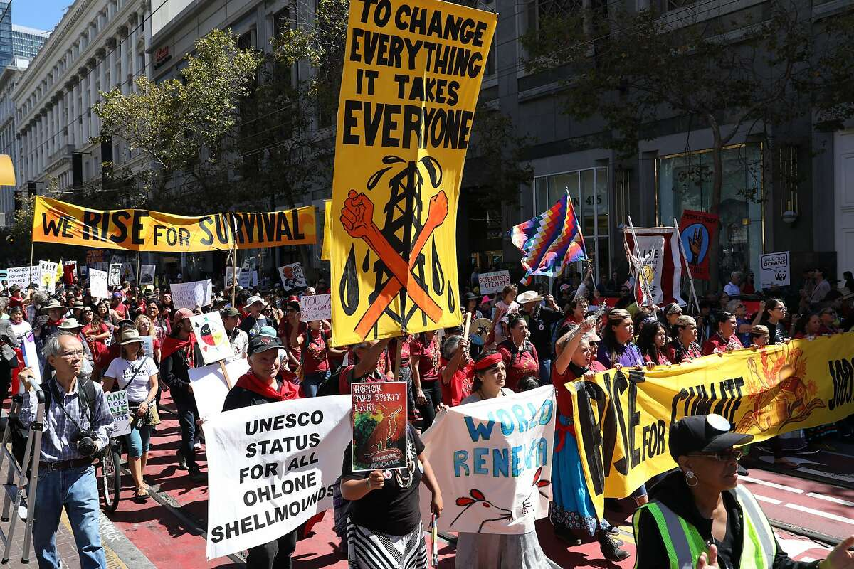 Demonstrators participate in the RISE for Climate, Jobs, and Justice march on Market Street on Saturday, September 8, 2018, in San Francisco, Calif. Thousands marched through the streets of San Francisco, just days before the Global Climate Action Summit next week.