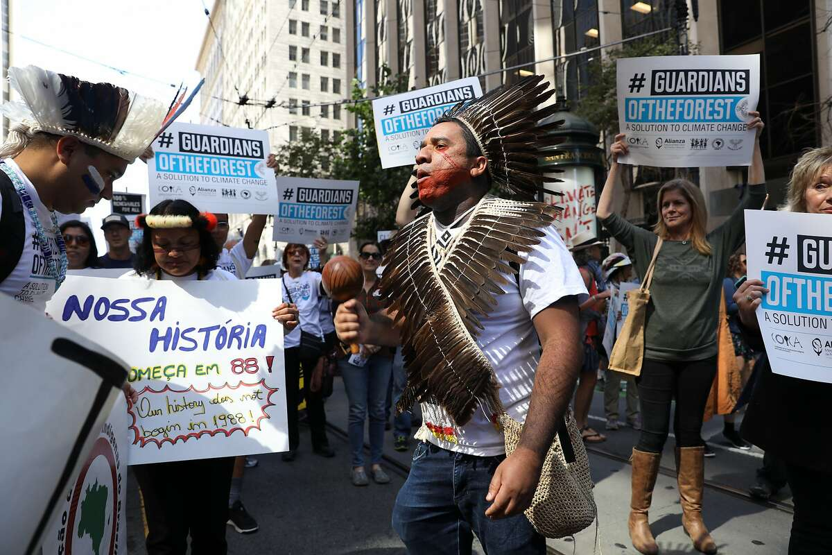 Dinamam Tux, with Articulation of Indigenous Peoples of Brazil (APIB) chants as he participates in the RISE for Climate, Jobs, and Justice march on Market Street on Saturday, September 8, 2018, in San Francisco, Calif. Thousands marched through the streets of San Francisco, just days before the Global Climate Action Summit next week.