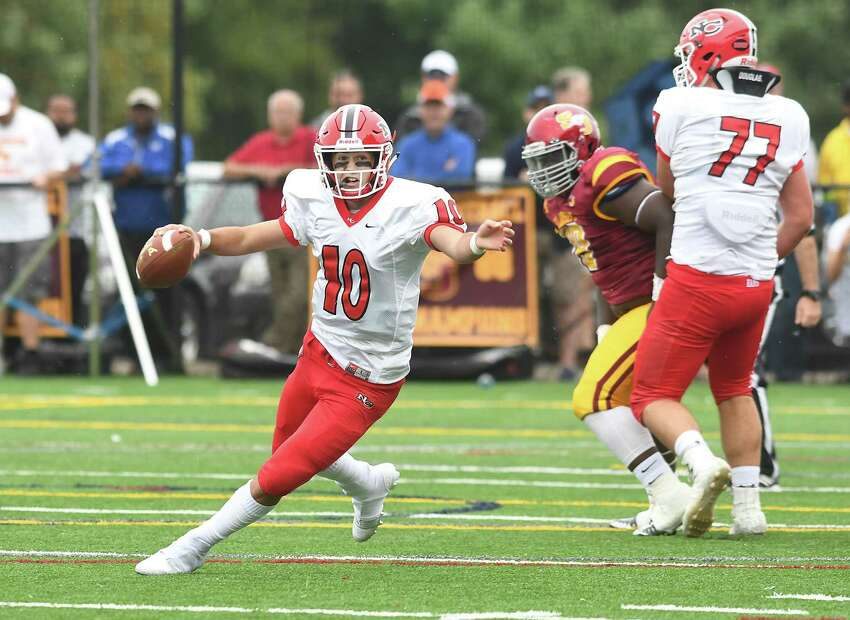 New Canaan quarterback Drew Byne during the New Canaan at St. Joseph football game, Sept. 8, 2018.