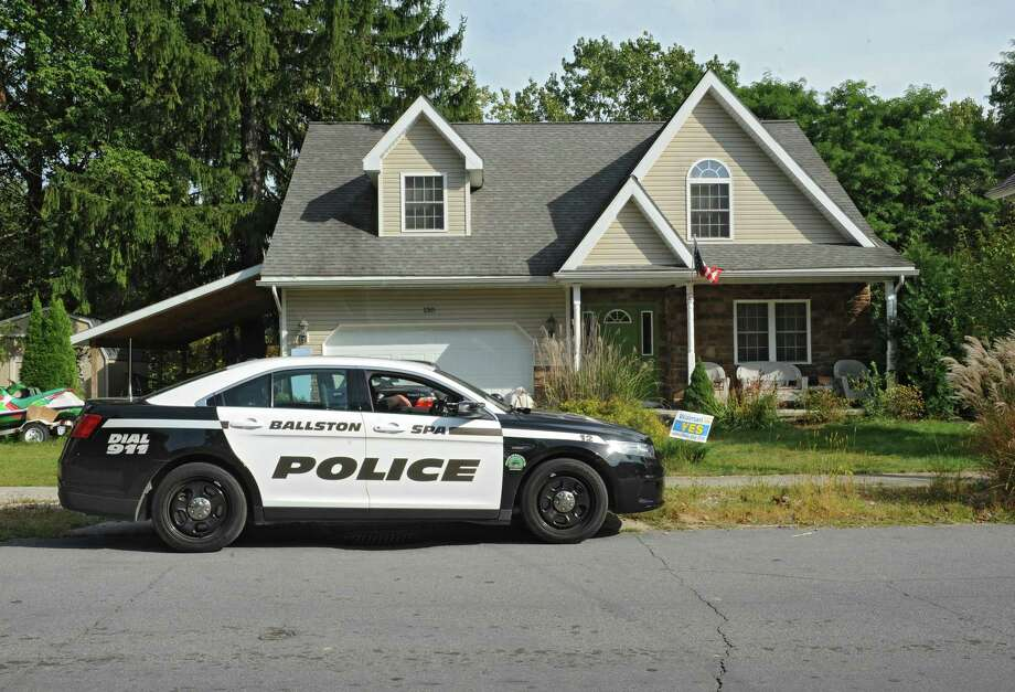 A Ballston Spa police car is parked in front of Daniel Satre's home during an investigation over the death of Satre of Ballston Spa who was Tasered by police multiple times after resisting arrest for disorderly conduct late Saturday night on Sunday, Sept. 21, 2014 in Ballston Spa, N.Y. (Lori Van Buren / Times Union) Photo: Lori Van Buren / 00028713A