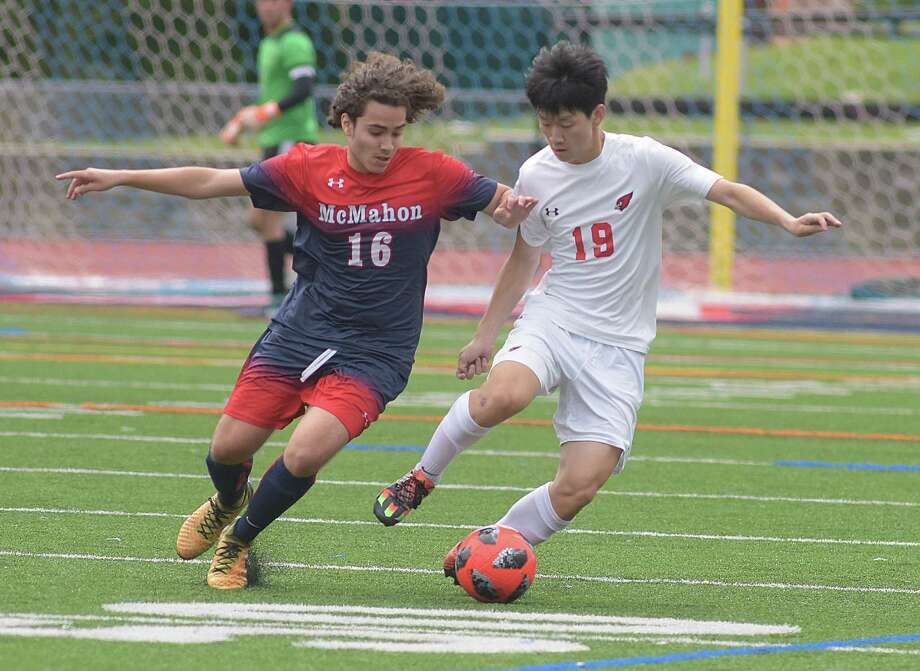Brien McMahon's Christopher Ocampo, left, and Greenwich's Woojin Kwak converge on a ball during Saturday's FCIAC season-opening game at Casagrande Field in Norwalk. The two teams battled to a 1-1 tie. Photo: John Nash / Hearst Media Connecticut