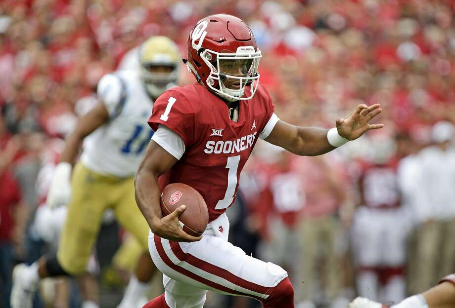 Oklahoma's Kyler Murray, who'll join the A's in 2019, passed for three touchdowns and ran for two more against UCLA. Photo: Brett Deering / Getty Images
