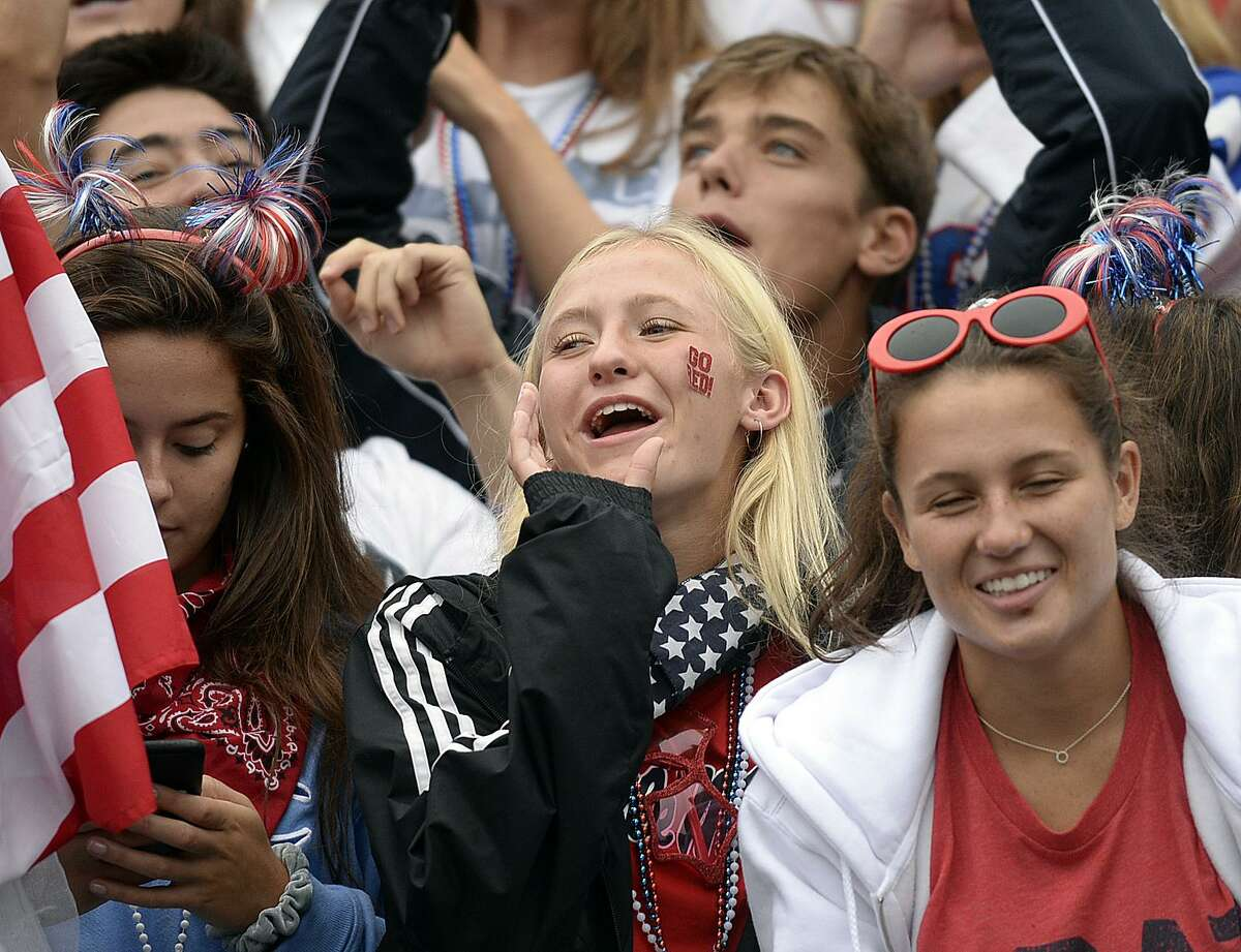 Greenwich fans cheer on their team during Saturday's football game at Greenwich High School against Trumbull on September 8, 2018.