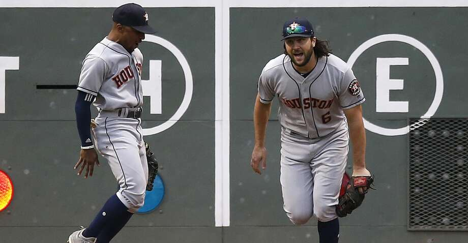 Houston Astros' Jake Marisnick (6) reacts beside Tony Kemp after making the catch on the fly out by Boston Red Sox's Andrew Benintendi during the fourth inning of a baseball game in Boston, Saturday, Sept. 8, 2018. (AP Photo/Michael Dwyer) Photo: Michael Dwyer/Associated Press