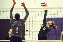 Metro-East Lutheran sophomore Caitlin Reynolds, right, goes up for a kill on Saturday during a pool-play match against Greenville at the Mascoutah Invitational.