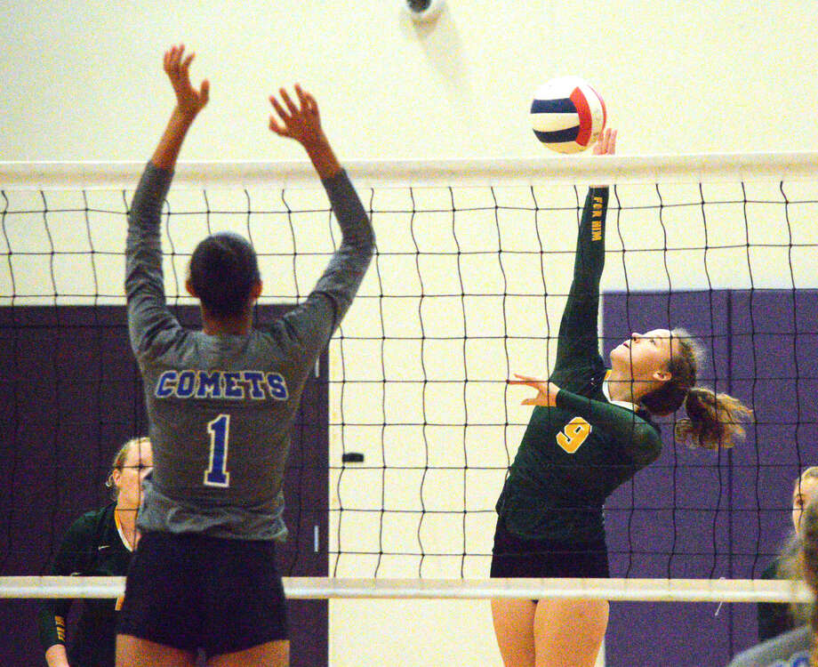 Metro-East Lutheran sophomore Caitlin Reynolds, right, goes up for a kill on Saturday during a pool-play match against Greenville at the Mascoutah Invitational. Photo: Scott Marion