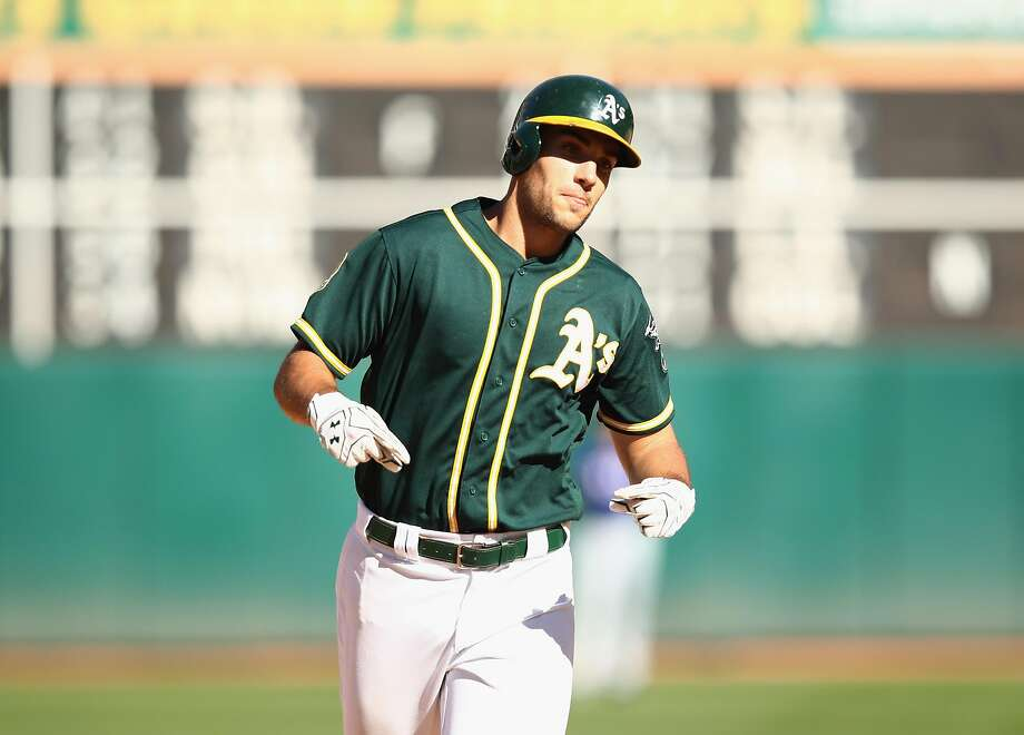 OAKLAND, CA - SEPTEMBER 08: Matt Olson #28 of the Oakland Athletics rounds the bases after hitting a home run in the eighth inning against the Texas Rangers at Oakland Alameda Coliseum on September 8, 2018 in Oakland, California. (Photo by Ezra Shaw/Getty Images) Photo: Ezra Shaw / Getty Images