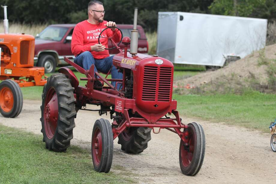 Tractors at the Octagon Barn Fall Family Days and during the tractor parade. Photo: Mike Gallagher/Huron Daily Tribune