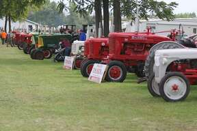 Tractors at the Octagon Barn Fall Family Days and during the tractor parade.
