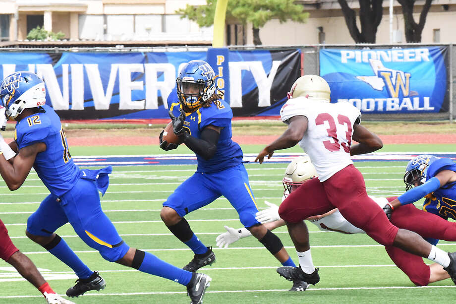 Wayland Baptist redshirt senior defensive back Richard Parham (center) picks up extra yards after picking off a pass with freshman defensive back Caleb Howard (12) helping to block during the Pioneers' season opener against Austin College on Saturday at Greg Sherwood Memorial Stadium in Plainview. Photo: Claudia Lusk/Wayland Baptist University