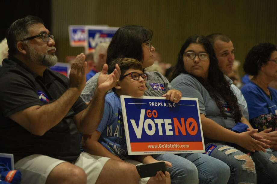 Gavin Perez, 10, listens to Gordon Harman speak during the #GoVoteNO rally in San Antonio on Saturday, September, 8, 2018 at La Villita Assembly Building. Organizers are seeking to stop propositions A, B and C that are on the November ballot. Photo: Carlos Javier Sanchez/pixelreflexmedia.com / Carlos Javier Sanchez|pixelreflexmedia.com / Carlos Javier Sanchez/pixelreflexmedia.com