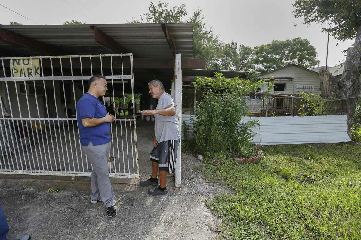 Harris County Public Health (HCPH) Dr. Umair A. Shah, MD talks with Hurricane Harvey victim Juan Cazares as staff and volunteers revisited the Aldine community Saturday, Sept. 8, 2018, in Houston. HCPH staff and volunteers assess their needs one year after Hurricane Harvey. The results will be shared with local, state and federal public partners to better understand how residents were impacted, what their current needs are and how to better prepare residents for future emergencies.
