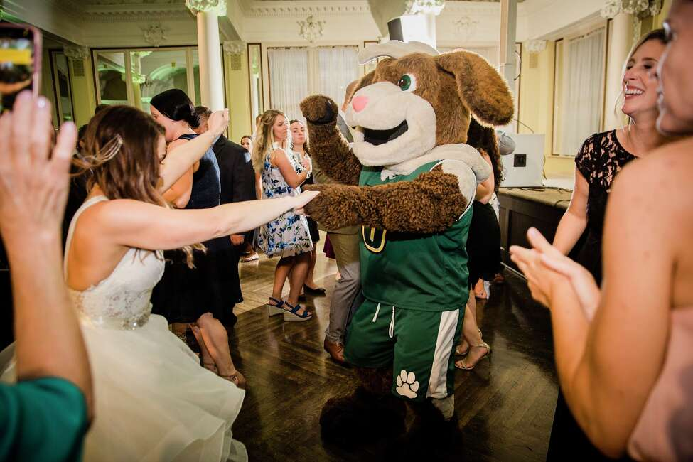 1. I'm a newlywed. I married my beautiful bride, Casey O'Donnell (formerly McNulty), on July 27 at the Canfield Casino. Only my soulmate would have suggested we invite the Siena mascot, Bernie, to hand out champagne to our wedding guests.