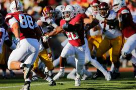 Stanford Cardinal running back Bryce Love (20) runs for a touchdown during the first quarter of an NCAA football game between Stanford Cardinal and USC Trojans at Stanford Stadium, Saturday, Sept. 8, 2018, in Stanford, Calif.