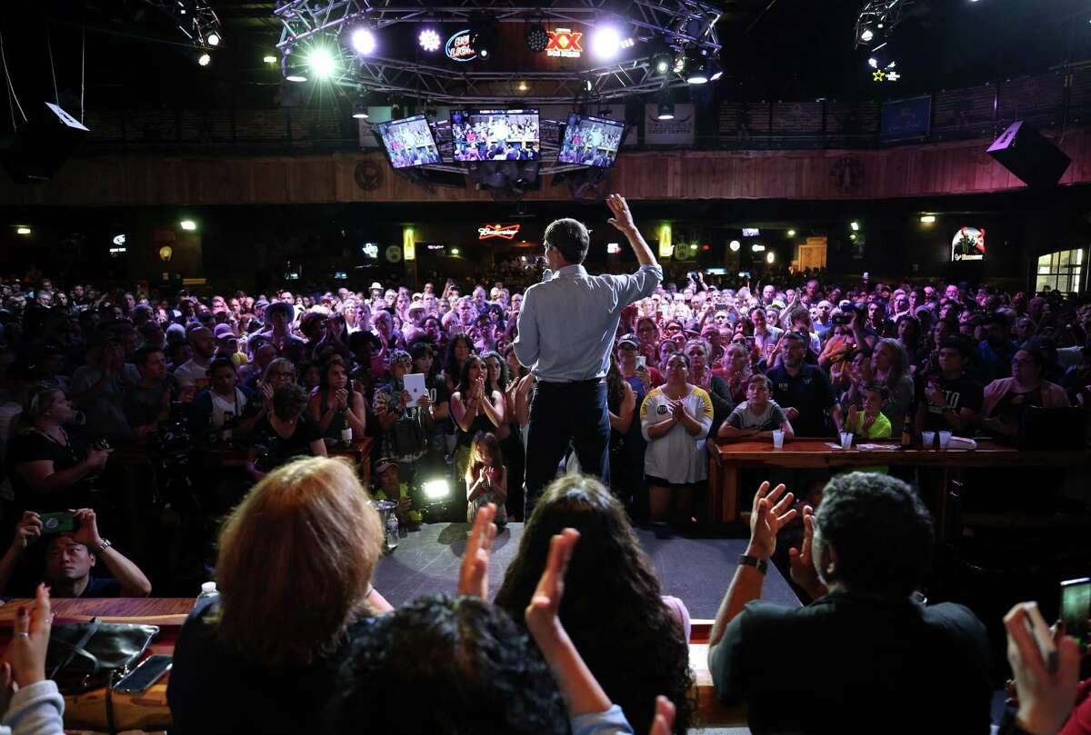 Beto O'Rourke, center, speaks to the crowd at his rally at the Houston Stampede Event Center Saturday, Sept. 8, 2018, in Houston.