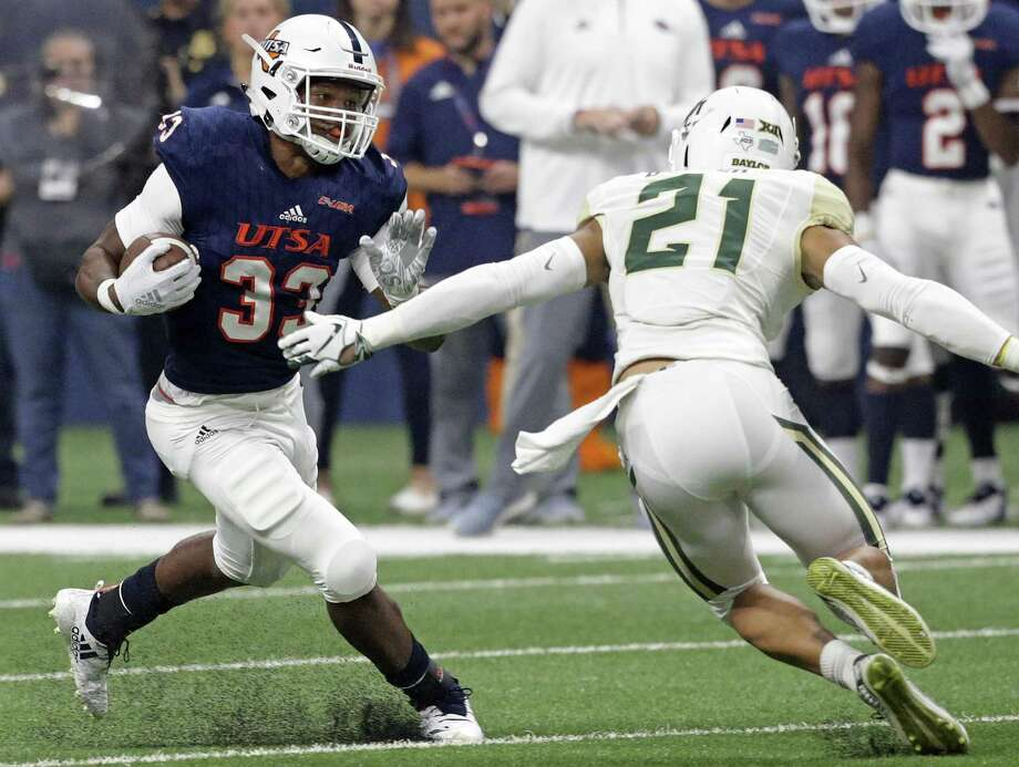 Runner Running back B.J. Daniels turns upfield on Blake Lynch as UTSA hosts Baylor in the first home game of the season for the Roadrunners on September 8, 2018. Photo: Tom Reel / Staff Photographer / 2017 SAN ANTONIO EXPRESS-NEWS