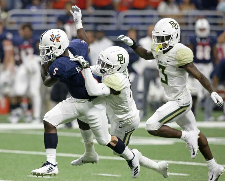 Roadrunner running back Jalen Rhodes is slowed down upfield after almost breaking into the clear as UTSA hosts Baylor in the first home game of the season for the Roadrunners on September 8, 2018.