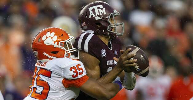 Clemson defensive end Justin Foster (35) sacks Texas A&M quarterback Kellen Mond (11) during the first half of an NCAA college football game Saturday, Sept. 8, 2018, in College Station, Texas. (AP Photo/Sam Craft) Photo: Sam Craft/Associated Press