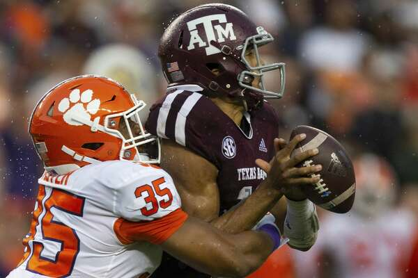 Clemson defensive end Justin Foster (35) sacks Texas A&M quarterback Kellen Mond (11) during the first half of an NCAA college football game Saturday, Sept. 8, 2018, in College Station, Texas. (AP Photo/Sam Craft)