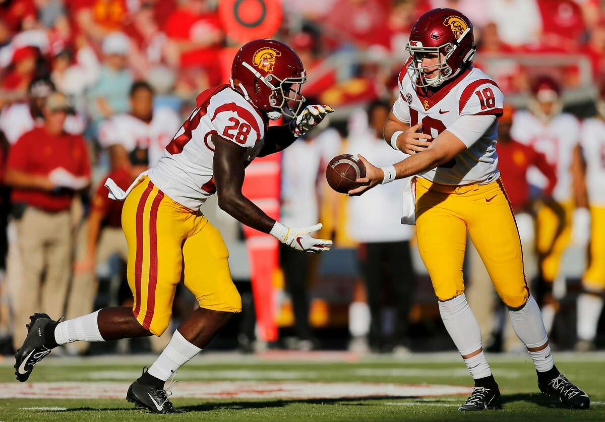USC Trojans quarterback J.T. Daniels (18) hands off the football to USC Trojans running back Aca'Cedric Ware (28) during the first quarter of an NCAA football game between Stanford Cardinal and USC Trojans at Stanford Stadium, Saturday, Sept. 8, 2018, in Stanford, Calif.