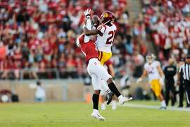 Stanford Cardinal cornerback Paulson Adebo (11) breaks up the pass against USC Trojans wide receiver Tyler Vaughns (21) during the second quarter of an NCAA football game between Stanford Cardinal and USC Trojans at Stanford Stadium, Saturday, Sept. 8, 2018, in Stanford, Calif.
