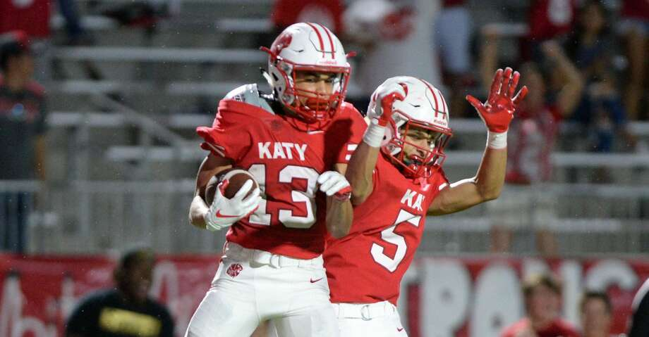 Jordan Patrick (13) and Steven Stiles (5) of Katy celebrate a reception that set-up a tying touchdown on the next play during the fourth quarter of a high school football game between the Katy Tigers and the Atascocita Eagles on Saturday, September 8, 2018 at Legacy Stadium, Katy, TX. Photo: Craig Moseley/Staff Photographer