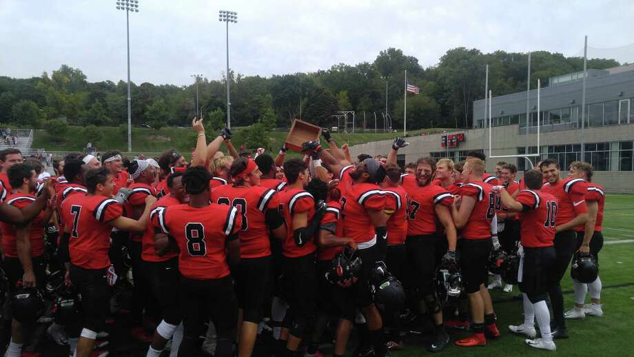 RPI players celebrate with the Transit Trophy, emblematic of winning their rivalry game against Worcester Polytechnic Institute 25-14 Saturday, Sept. 8, 2018, at ECAV Stadium in Troy. (Pete Dougherty / Times Union)