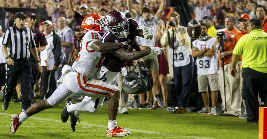 Texas A&M wide receiver Quartney Davis (1) has the ball punched out of his hands for a touchback by Clemson defensive back K'Von Wallace (12) during the fourth quarter of an NCAA college football game Saturday, Sept. 8, 2018, in College Station, Texas. (AP Photo/Sam Craft) Photo: Sam Craft/Associated Press