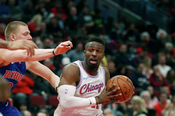 FILE - In this April 11, 2018 photo, Chicago Bulls forward David Nwaba (11) looks to pass against the Detroit Pistons during the second half of an NBA basketball game in Chicago. The Cavaliers continued their post-LeBron James makeover, signing free agent guard Nwaba to a one-year contract. Nwaba?'s deal is for the veteran?'s minimum of $1.5 million. (AP Photo/Jeff Haynes, File)