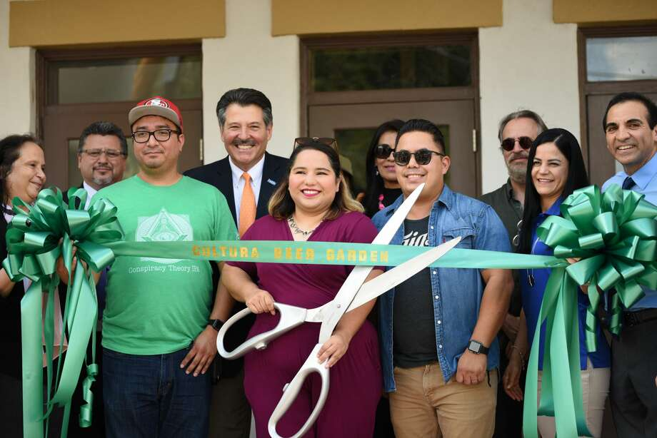 The ceremonial ribbon is cut as owners Benny, Val and Chris Contreras officially open Cultura Beer Garden in their new location, Wednesday, September 5, 2018. Photo: Christian Alejandro Ocampo