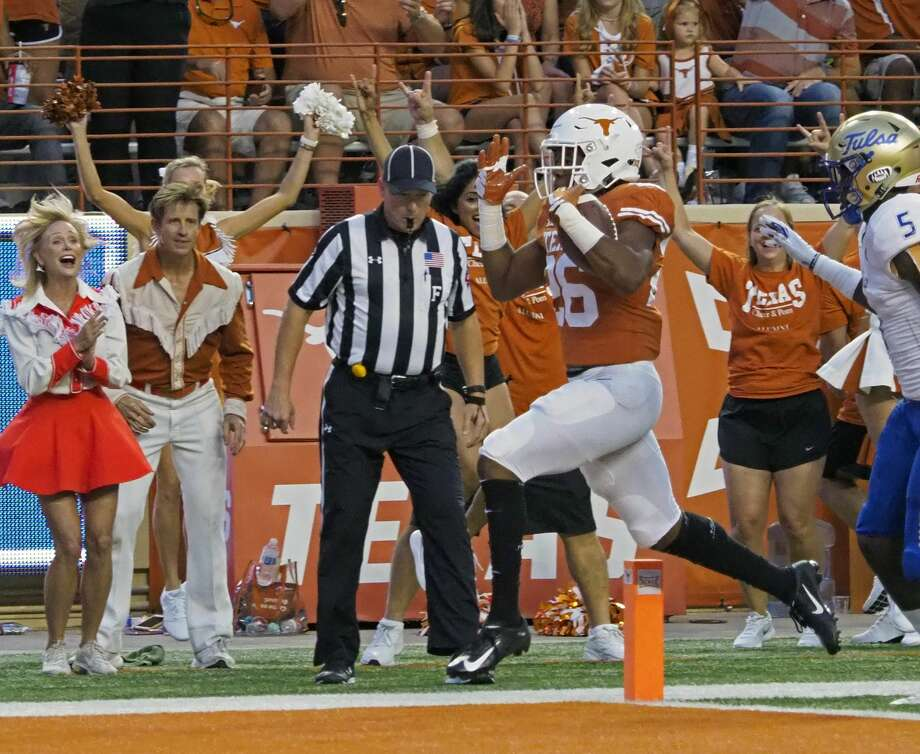 Texas running back Keaontay Ingram (26) scores a touchdown in front of Tulsa safety McKinley Whitfield (5) during the first half of an NCAA college football game Saturday, Sept. 8, 2018, in Austin, Texas. (AP Photo/Michael Thomas) Photo: Michael Thomas/Associated Press