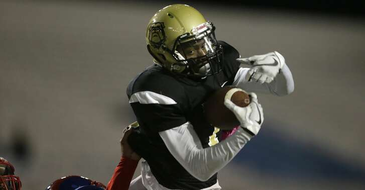 North Forest Bulldogs Demond Demas (1) catches a pass in the end zone for a touchdown in the first half during the high school football game between Kashmere Fighting Rams and the North Forest Bulldogs at Delmar Stadium in Houston, TX on Thursday, October 26, 2017.