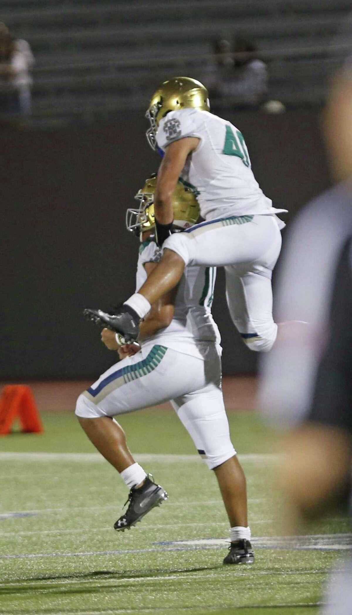 Holy Cross Alvardo Mason jumps on Michael Kalijah after the sack to end the game. Central Catholic v Holy Cross at Alamo Stadium on Sat, September 8, 2018.