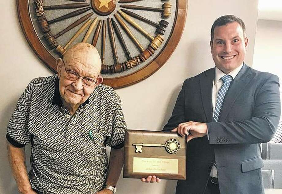 "South Jacksonville Mayor Harry Jennings (right) presents John ""Sherm"" Gotschall the key to the village Thursday during a reception in his honor. Gotschall has given 40 years of service to the village as a member of its Board of Trustees. Photo: Photo Provided"