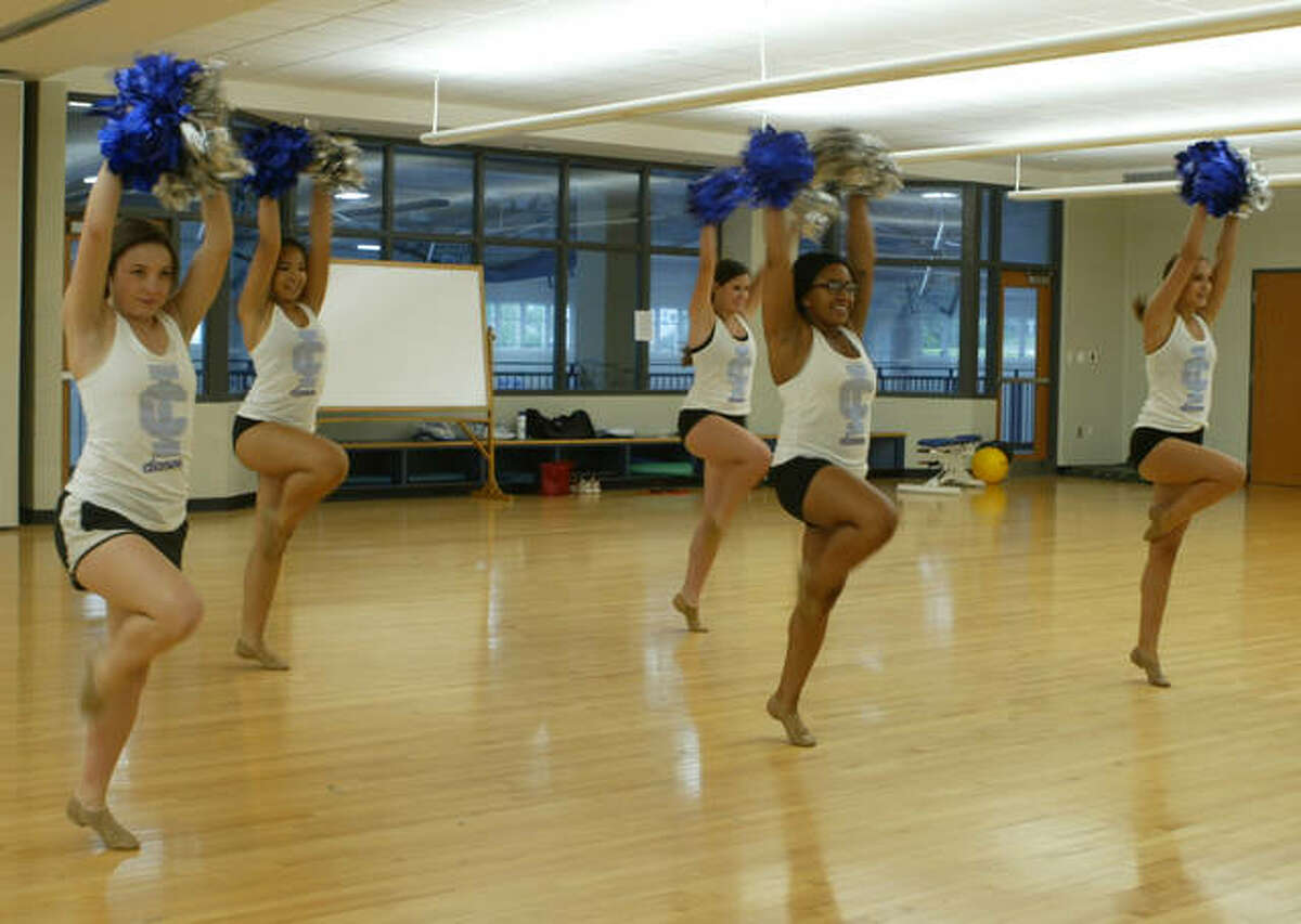 Members of the Illinois College dance team practice for their upcoming performance at Busch Stadium.